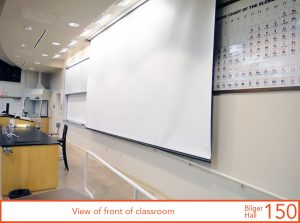 View of front of classroom, projection screen down