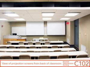 View of projection screens from back of classroom