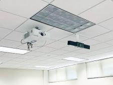 Webcam (black) installed beside projector (white)