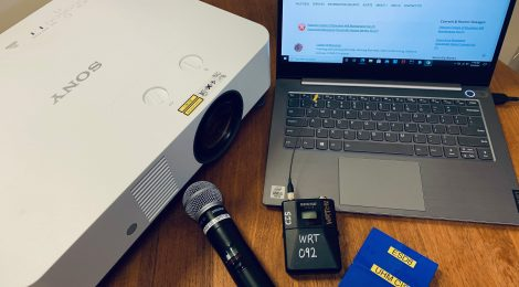 Photo of some equipment available to loan: projector, wireless microphones, laptop.